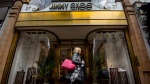 """FILE - This is a April 24, 2017 file photo of the Jimmy Choo shop on New Bond Street, London. American fashion brand Michael Kors has bought luxury shoemaker Jimmy Choo in a deal worth $1.35 billion (896 million pounds.) Kors said Tuesday July 25, 2017 the London-listed Jimmy Choo is """"the ideal partner"""" that will be bolstered with further development of its online presence. (Lauren Hurley/PA, File via AP)"""