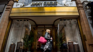 "FILE - This is a April 24, 2017 file photo of the Jimmy Choo shop on New Bond Street, London. American fashion brand Michael Kors has bought luxury shoemaker Jimmy Choo in a deal worth $1.35 billion (896 million pounds.) Kors said Tuesday July 25, 2017 the London-listed Jimmy Choo is ""the ideal partner"" that will be bolstered with further development of its online presence. (Lauren Hurley/PA, File via AP)"