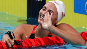Canada's gold medal winner Kylie Jacqueline Masse celebrates after setting a new world record in the women's 100-meter backstroke final during the swimming competitions of the World Aquatics Championships in Budapest, Hungary, Tuesday, July 25, 2017. (AP Photo/Michael Sohn)