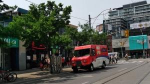 A Canada Post truck is seen blocking a bike lane. (Kyle Ashley/ Twitter)