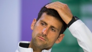 This is a Wednesday, July 12, 2017 file photo of Serbia's Novak Djokovic as he gestures during a press conference after losing his Men's Singles Quarterfinal Match against Czech Republic's Tomas Berdych on day nine at the Wimbledon Tennis Championships in London. Novak Djokovic will miss the rest of this season because of an injured right elbow. The 12-time major champion will skip the U.S. Open. That ends his streak of playing in 51 consecutive Grand Slam tournaments. (AELTC, Joe Toth/File via AP)
