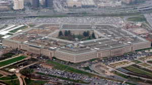 In this March 27, 2008 file photo, the Pentagon is seen in this aerial view in Washington. President Donald Trump says he will bar transgender individuals from serving in any capacity' in the armed forces. Trump said on Twitter Wednesday, July 26, 2017, that after consulting with generals and military experts, that the U.S. Government will not accept or allow Transgender individuals to serve in any capacity in the U.S. Military.  (AP Photo/Charles Dharapak, File)
