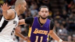 Los Angeles Lakers guard Tyler Ennis (11) drives against San Antonio Spurs guard Tony Parker, of France, during the first half of an NBA basketball game, Wednesday, April 5, 2017, in San Antonio. (AP Photo/Darren Abate)