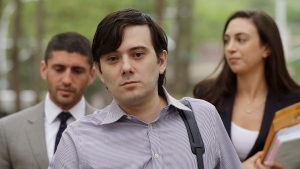 In this June 19, 2017 file photo, former Turing Pharmaceuticals CEO, Martin Shkreli, center, arrives at Brooklyn federal court in New York with members of his legal team. Jurors heard testimony from the government's last witness on Tuesday, July 25, 2017, a day after Shkreli's lawyer told the court his client won't take the witness stand during his securities fraud trial. (AP Photo/Mark Lennihan, File)