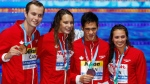 Canada's Yuri Kisil, Penny Oleksiak, Richard Funk and Kylie Jacqueline Masse, from left, show off their bronze medal for the mixed medley relay event during the swimming competitions of the World Aquatics Championships in Budapest, Hungary, Wednesday, July 26, 2017. (AP Photo/Darko Bandic)
