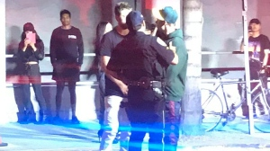 "Popstar Justin Bieber, right speaks with two people after an incident in Los Angeles Wednesday July 26, 2016. Police say Justin Bieber accidentally struck a photographer with his pickup truck in Beverly Hills. The Los Angeles Times reported that police Sgt. Matthew Stout said the 57-year-old photographer was hospitalized Wednesday night with injuries that were not life-threatening. The newspaper said Bieber ""fully cooperated"" with officers at the scene. (Alex Hager via AP)"