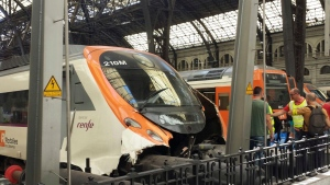 The front of a commuter train wrecked after it ran into the buffers at a train station in Barcelona, Spain, Friday July 28, 2017. The morning commuter passenger train ran into the buffers leaving many people injured according to Catalan government officials Friday. (AP Photo/Joseph Wilson)