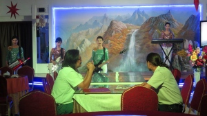 In this Tuesday, July 25, 2017 photo, waitresses sing at the Pyongyang Okryu-Gwan North Korean Restaurant in Dubai, United Arab Emirates. From state-run restaurants to construction sites, North Korean workers in Kuwait, Oman, Qatar and the United Arab Emirates face conditions akin to forced labor while being spied on by planted intelligence officers, eating little food and suffering physical abuse, authorities say. (AP Photo/Kamran Jebreili)