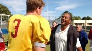 In this Dec. 28, 2002, file photo, University of Southern California quarterback Carson Palmer talks to O.J. Simpson after practice for the Orange Bowl in Davie, Fla. The two are winners of the Heisman trophy. USC head coach Todd Helton told reporters on July 27, 2017, that Simpson wouldn't be invited to watch practice or take part in any official functions at his alma mater this fall following his release from prison. (AP Photo/J. Pat Carter, File)