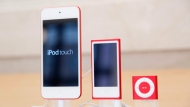 In this June 11, 2015, file photo, from left, an iPod, iPod Nano and iPod Shuffle are displayed at an Apple store in New York. The company discontinued sales of the iPod Nano and iPod Shuffle on Thursday, July 27, 2017, in a move reflecting the waning popularity of the devices in an era when most people store or stream their tunes on smartphones. (AP Photo/Mark Lennihan, File)
