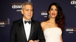 Actor George Clooney and Amal Clooney arrive at the 42nd Cesar Film Awards ceremony at Salle Pleyel in Paris, Friday, Feb. 24, 2017. (AP Photo/Francois Mori)
