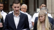 In this file photo dated Monday, July 24, 2017, Chris Gard, the father of critically ill baby Charlie Gard reads a statement next to mother Connie Yates, right, at the end of their case at the High Court in London. British media are reporting a family announcement that 11-month old Charlie Gard, has died Friday July 28, 2017. (AP Photo/Matt Dunham, FILE)