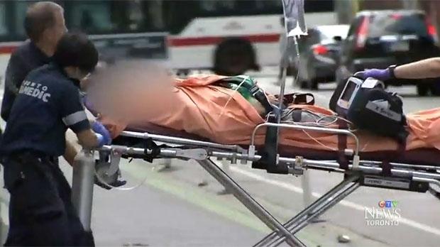 Toronto paramedics transport a victim of an overdose to hospital on Sunday, July 30, 2017.