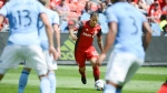Toronto FC''s Sebastian Giovinco (center) shoots through the New York City FC defence to score a goal during the first half of their MLS soccer game Sunday, July 30, 2017 in Toronto. THE CANADIAN PRESS/Jon Blacker