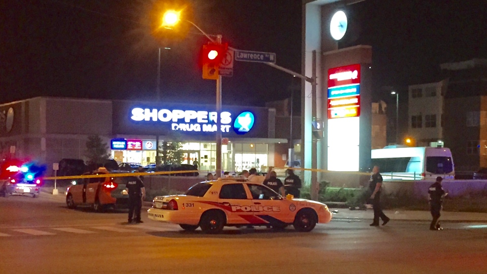 Police are investigating after a man was found with a gunshot wound in the parking lot of a Lawrence Heights strip mall on Monday morning. (Mike Nguyen/ CP24)