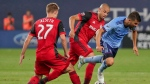 New York City FC forward David Villa, right, trips as he is challenged for control of the ball by Toronto FC defender Oyvind Alseth (27) and defender Jason Hernandez during the second half of an MLS soccer game, Wednesday, July 19, 2017, in New York. There was some good news for Toronto FC on the injury front Tuesday with coach Greg Vanney confirming that wingback Alseth's foot injury is not serious. THE CANADIAN PRESS/AP/Julie Jacobson