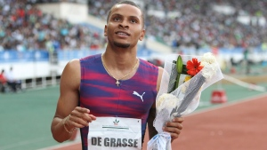 In this July 16, 2017 file photo, Canadian Andre De Grasse celebrates after winning the men's 200-meter at the International Mohammed VI track and field meeting in Rabat, Morocco.  (AP Photo/Abdeljalil Bounhar, File)