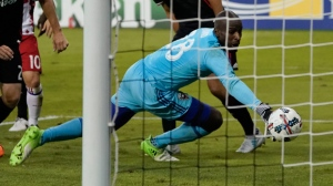 D.C. United goalkeeper Bill Hamid watches the ball go past him for a Toronto FC goal during the second half of an MLS soccer match Saturday, Aug. 5, 2017, at RFK Stadium in Washington. The game ended in a 1-1 draw. (AP Photo/Pablo Martinez Monsivais)
