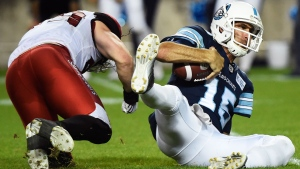 Toronto Argonauts quarterback Ricky Ray (15) is sacked by Calgary Stampeders linebacker Alex Singleton (49) during second half CFL football action in Toronto on Thursday, August 3, 2017. Argonauts quarterback Ray is day-to-day with a shoulder injury and could play Friday when Toronto visits the Montreal Alouettes.THE CANADIAN PRESS/Nathan Denette