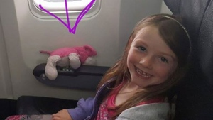 Phoebe and 'Sleepy dog' are pictured on their way to Toronto before the stuffed toy was lost at the Eaton Centre. (Facebook)