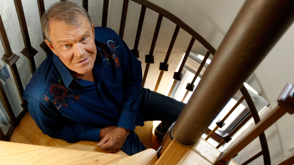 In this July 27, 2011 photo, musician Glen Campbell poses for a portrait in Malibu, Calif. (AP Photo/Matt Sayles, File)