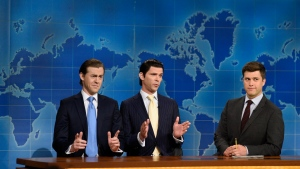 "This August 10, 2017, photo provided by NBC shows Alex Moffat as Eric Trump, left, Mikey Day as Donald Trump Jr., center, and Colin Jost on set during the debut episode of ""Weekend Update: Summer Edition,"" in New York. The ""Saturday Night Live"" spinoff runs through the end of the month. (Rosalind O'Connor/NBC via AP)"