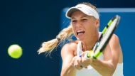 Caroline Wozniacki, of Denmark, returns the ball against Sloane Stephens, of the United States, during women's semi-final Rogers Cup tennis action in Toronto on Saturday, August 12, 2017. Wozniacki won the match, advancing to the finals. THE CANADIAN PRESS/Nathan Denette