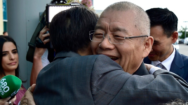 Pastor Hyeon Soo Lim (right) is hugged as he arrives at the Light Presbyterian Church in Mississauga, Ont., Sunday, August 13, 2017. Lim was released from prison last week in North Korea, where he had been serving a life sentence with hard labour for anti-state activities. THE CANADIAN PRESS/Frank Gunn