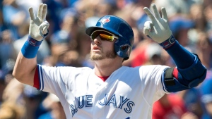 Toronto Blue Jays Josh Donaldson crosses home plate after hitting a two-run home run against the Pittsburgh Pirates in the first inning of their interleague MLB baseball game in Toronto on Sunday, August 13, 2017. THE CANADIAN PRESS/Fred Thornhill