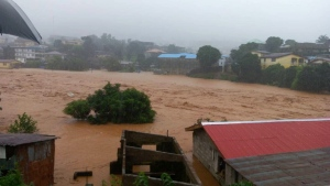 In this image made available by Society 4 Climate Change Communication, Sierra Leone, mud and water flow in Freetown Sierra Leone Monday Aug. 14, 2017. (Society 4 Climate Change Communication via AP)