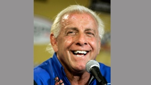 "In this Sept. 22, 2007, file photo, wrestler Ric Flair addresses the media during a news conference at Dover International Speedway in Dover, Del. Flair's representative said on Twitter Aug. 14, 2017, that Flair was dealing with some ""tough medical issues."" (AP Photo/Carolyn Kaster, File)"