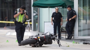 "A police officer photographs a motorcycle after a female stunt driver working on the movie ""Deadpool 2"" died after a crash on set, in Vancouver, B.C., on Monday August 14, 2017. Vancouver police say the driver was on a motorcycle when the crash occurred on the movie set on Monday morning. THE CANADIAN PRESS/Darryl Dyck"