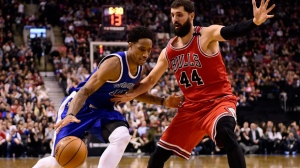 Toronto Raptors guard DeMar DeRozan (10) drives past Chicago Bulls forward Nikola Mirotic (44) during second half NBA basketball action, in Toronto on Tuesday, March 21, 2017. THE CANADIAN PRESS/Frank Gunn