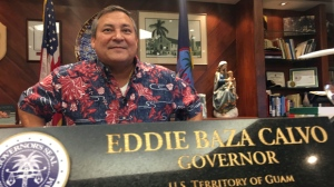"Guam Gov. Guam Eddie Baza Calvo speaks to the media in his office in Adelup, Guam, Friday, Aug. 11, 2017. The small U.S. territory of Guam has become a focal point after North Korea's army threatened to use ballistic missiles to create an ""enveloping fire"" around the island. The exclamation came after President Donald Trump warned Pyongyang of ""fire and fury like the world has never seen."" (AP Photo/Tassanee Vejpongsa)"