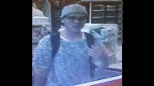 Police have released photos of a suspect wanted in connection with a bomb threat investigation at Bloor-Yonge Station. (Toronto Police Service handout)