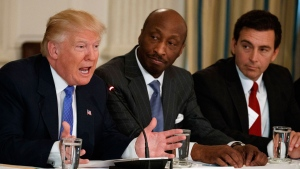 In this Thursday, Feb. 23, 2017, file photo, President Donald Trump, left, speaks during a meeting with manufacturing executives at the White House in Washington, including Merck CEO Kenneth Frazier, center, and Ford CEO Mark Fields. (AP Photo/Evan Vucci, File)