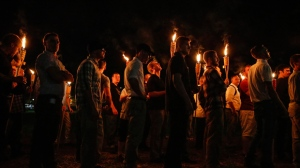 In this Friday, Aug. 11, 2017 photo, multiple white nationalist groups march with torches through the UVA campus in Charlottesville, Va. (Mykal McEldowney/The Indianapolis Star via AP)