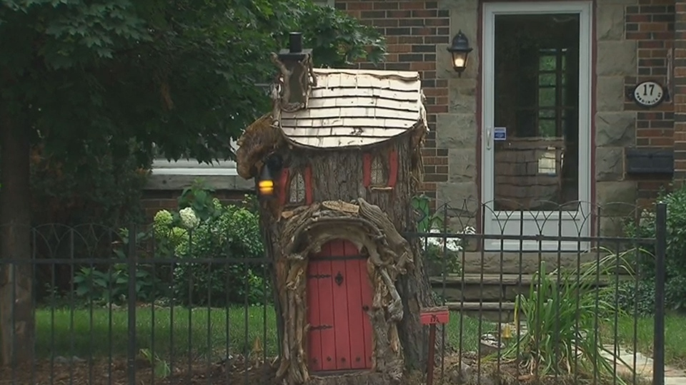 Haywoods Hollow, a tiny fairytale cottage carved from a tree stump in front of Billy Watterson's Brampton home, is pictured.