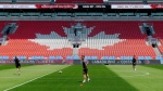 Team Canada women's national team head coach John Herdman looks on as his team practices at BMO Field in Toronto on Saturday, June 10, 2017. THE CANADIAN PRESS/ Neil Davidson