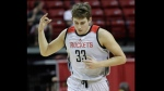 Houston Rockets' Kyle Wiltjer reacts after scoring against the Sacramento Kings during the first half of an NBA summer league basketball game, Sunday, July 10, 2016, in Las Vegas. (AP Photo/John Locher)