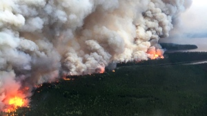 A forest fire burns near Nibinamik, Ont. in a handout photo from the Ontario Ministry of Natural Resources. Smoke from an increasing number of forest fires in northwestern Ontario has prompted the evacuation of a First Nation in the region, officials said Tuesday. THE CANADIAN PRESS/HO-Ontario Ministry of Natural