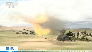"In this image taken from a recent video footage run by China's CCTV on Friday, Aug 4, 2017 via AP Video, artillery guns fire during a live-fire drill by the Chinese army in China's Tibet Autonomous Region that border India. Beijing is intensifying its warnings to Indian troops to get out of a contested region high in the Himalayas where China, India and Bhutan meet, saying China has been restrained but ""restraint has its limits."" Chinese characters in yellow reads ""Artillery soldiers high altitude live fire drills."" (CCTV via AP Video)"