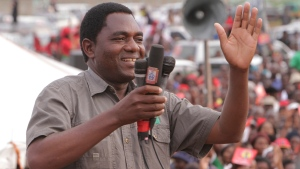 In this Jan. 2015 file photo Hakainde Hichilema, of the Zambia opposition United Party for National Development addresses an election rally in Lusaka, Zambia. The Lusaka high court has dropped treason charges against Hichilema and released him from custody. (AP Photo/Tsvangirayi Mukwazhi, File)