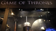 This is a Tuesday, June 10, 2014 file photo of weapons from the Game of Thrones are on display at the Waterfront Hall, Belfast, Northern Ireland. (AP Photo/Peter Morrison, File)