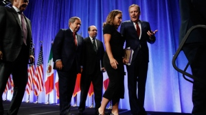 U.S. Trade Representative Robert Lighthizer, right, speaks with Canadian Foreign Affairs Minister Chrystia Freeland, as they leave a news conference, which included Mexico's Secretary of Economy Ildefonso Guajardo Villarreal, Wednesday, Aug. 16, 2017, at the start of NAFTA renegotiations in Washington. (AP Photo/Jacquelyn Martin)