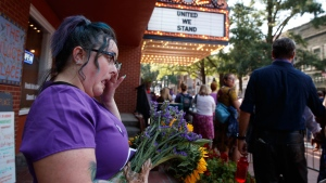 Cynthia Sullivan of Charlottesville, Va., stands in line for a memorial service for Heather Heyer, who was killed during a white nationalist rally, Wednesday, Aug. 16, 2017, in Charlottesville, Va. (AP Photo/Evan Vucci)