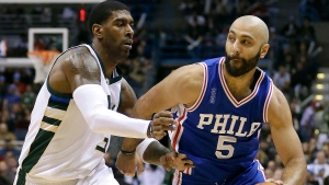In this Wednesday, Dec. 25, 2015 file photo, Philadelphia 76ers' Kendall Marshall (5) drives against Milwaukee Bucks' O.J. Mayo during an NBA basketball game in Milwaukee. The jerseys say USA, though that's about all that will be recognizable. The Americans are cautiously entering a whole new basketball world, one in which not only are the best U.S. players not available, but neither are any in the NBA. LeBron James, Kevin Durant and the stars might show up in a few years for the Basketball World Cup and Olympics, but only if a group of minor leaguers can get them there. (AP Photo/Aaron Gash, File)