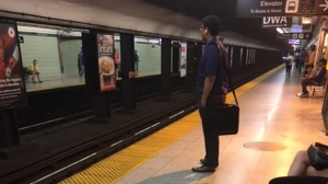 A TTC customer is seen waiting for a train at Woodbine Station. (Nathan Downer/ CP24)