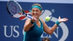 "In this Sept. 3, 2015, file photo, Victoria Azarenka, of Belarus, returns a shot to Yanina Wickmayer, of Belgium, during the second round of the U.S. Open tennis tournament, in New York. Two-time Australian Open champion Victoria Azarenka says her participation in the U.S. Open is in doubt because she might not be able to bring her baby son with her to New York as a result of her separation from the child's father. Azarenka says via a posting on Twitter on Thursday, Aug. 17, 2017, that she is ""faced with a difficult situation which may not allow me to return to work right away."" (AP Photo/Charles Krupa, File)"