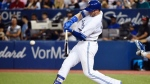 Toronto Blue Jays first baseman Justin Smoak (14) hits a two-run home run against the Tampa Bay Rays during eighth inning AL baseball action in Toronto on Thursday, August 17, 2017. THE CANADIAN PRESS/Nathan Denette